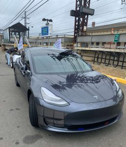 Westport Police Model 3 with Flags for EV Parade