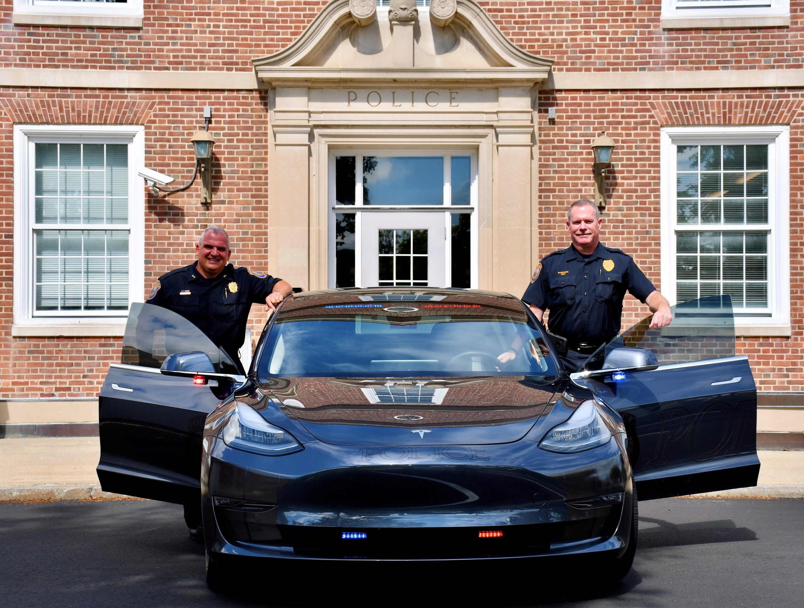 Westport Chief of Police Foti Koskinas and Officer Charles Sampson with the Tesla Model 3 Police Patrol Car