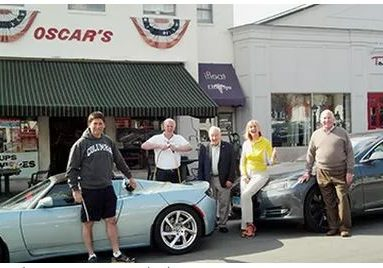 Left to right: Avi Kaner (second selectman), Lee Papageorge (Oscar's owner),Leo Cirino (WECC president), Robin Tauck (her 2 Teslas), Jim Marpe (first selectman) Main Street in front of Oscar's Deli, Saturday, March 22, 2014.